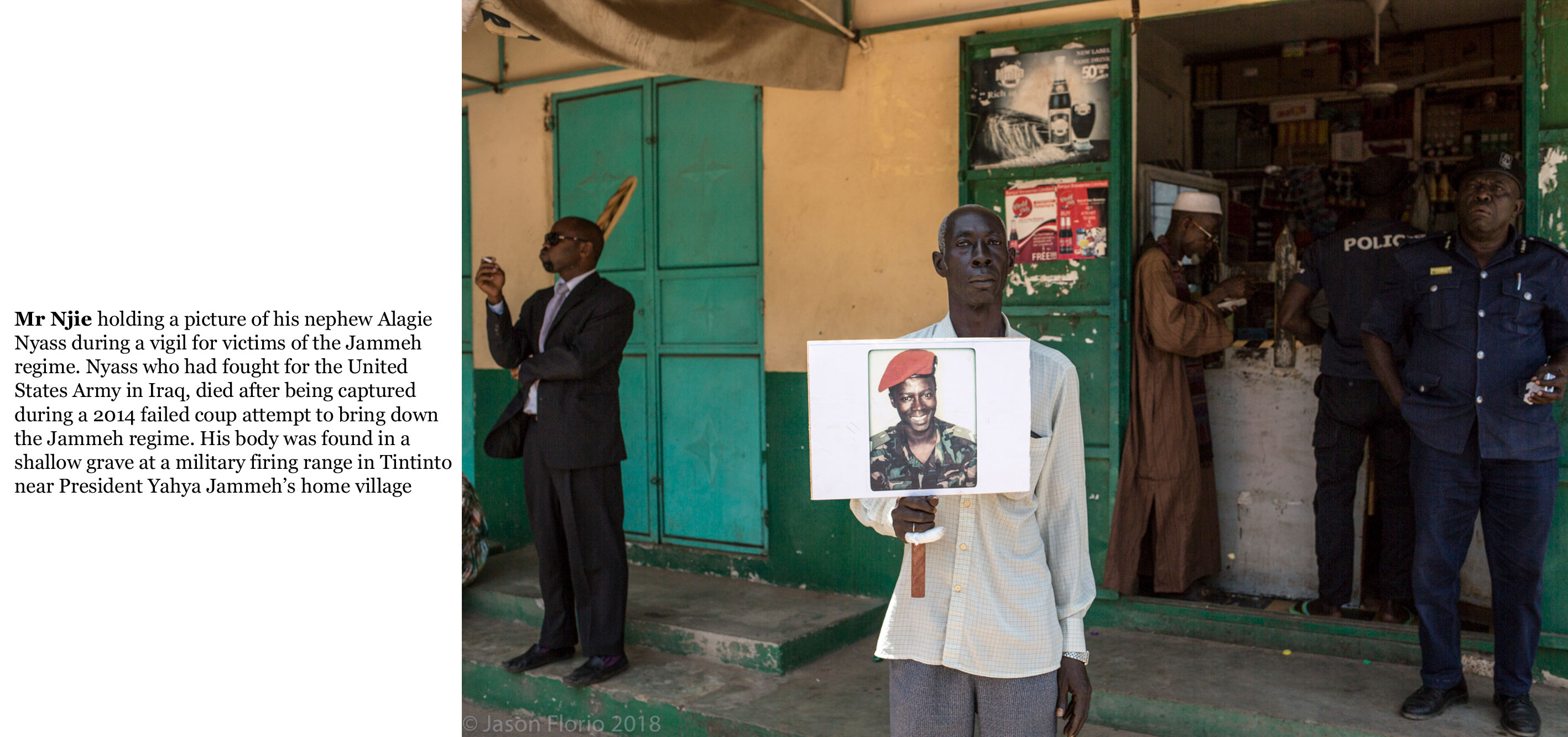 Gambia victims and resisters -Mr Nyass holds a placard with a photo of his nephew, Gambian soldier Alagie Nyass who was captured and killed during 2014 failed coup -21_TEXT-_web