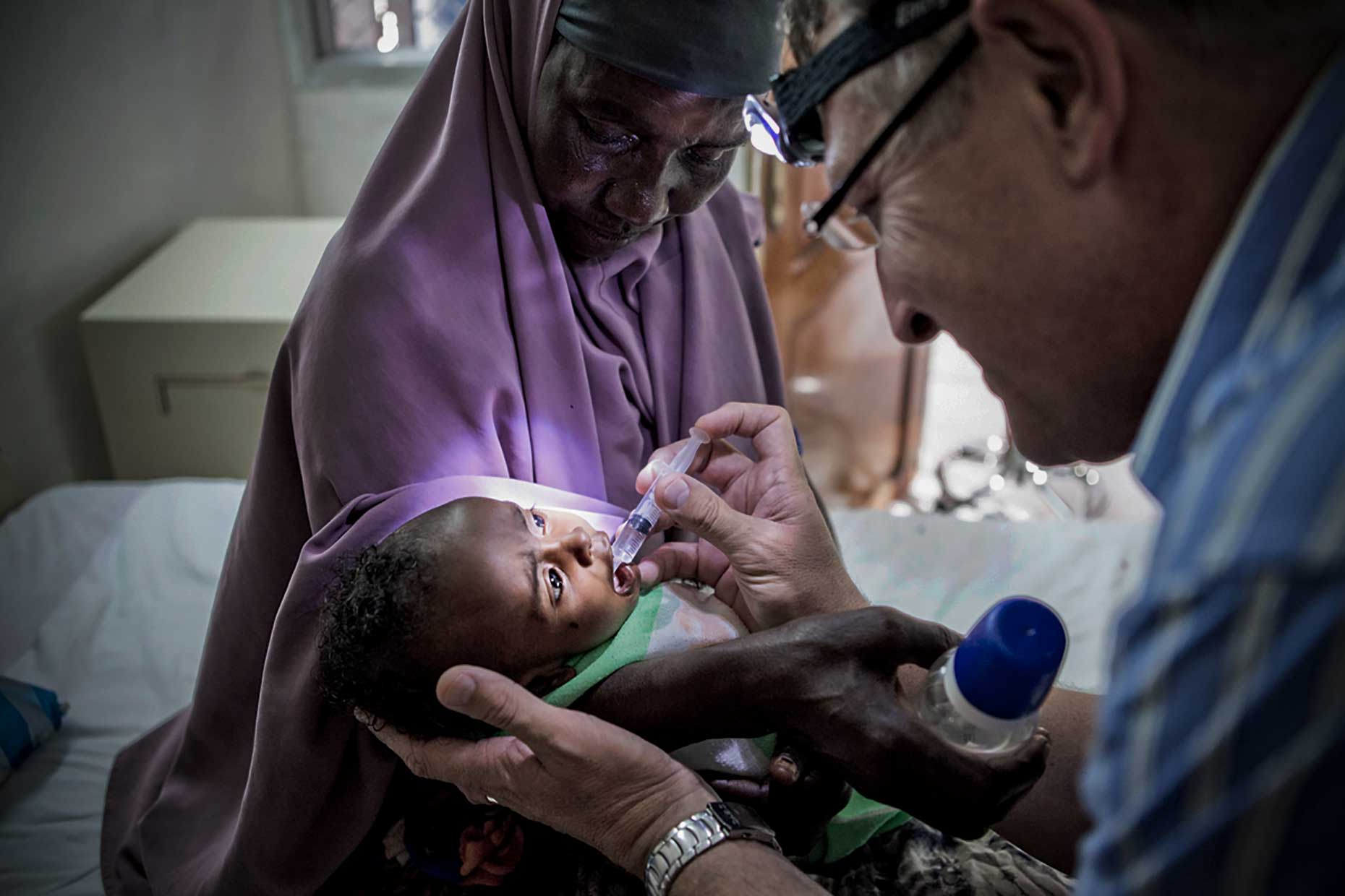 Doctor helping a dehydrated child